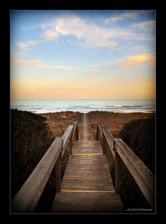 """SUnset Walkway"" was shot from a friends ocean side home. There was this most amazing, long walkover the seaoats and dunes to the beach."