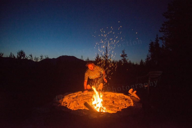 My son Derek tending the campfire.