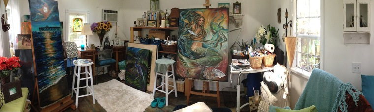 I used the pano feature on mu cell phone to capture the interior of my painting studio. Its missing the other half to my back but you get the idea. Its only 10x14 feet but has two skylights so I have great light to paint by...and I can sit in my rocking chair enjoying music while I create. I love it!!!