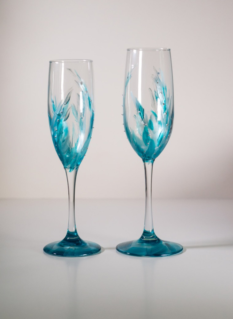 I paint glassware and fire them so they are permanent. I recently had two commissions for the candle holders for a wedding (8) and various flutes.