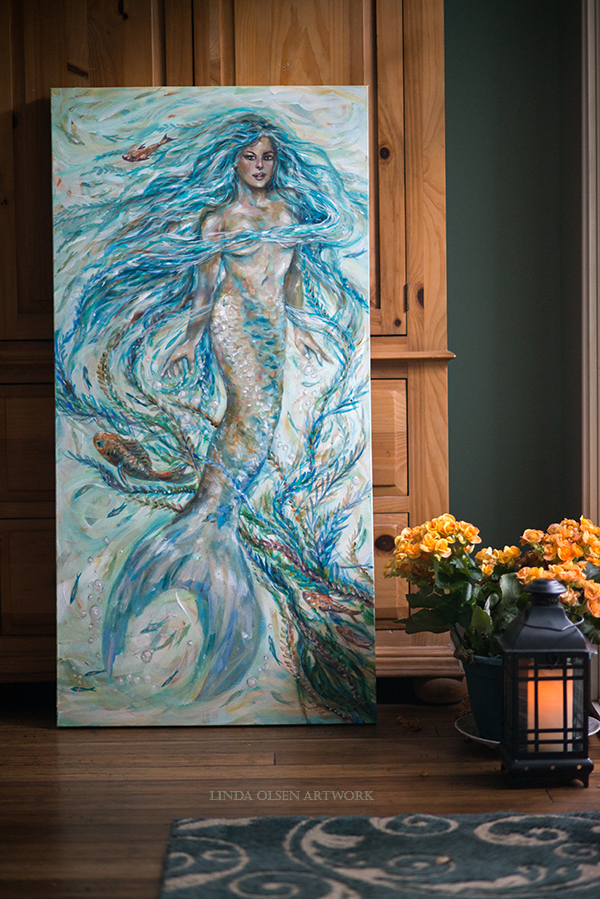 """Mermaid Locks"" is a new mermaid painting. 24x48"". I was started in early January and went through many transitions. I wanted to make her long hair stem from the seaweed.  She looks a bit stoic about being tangled up."